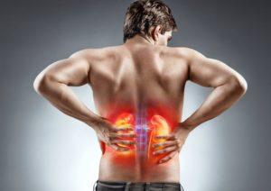 Распирающая боль в области почек